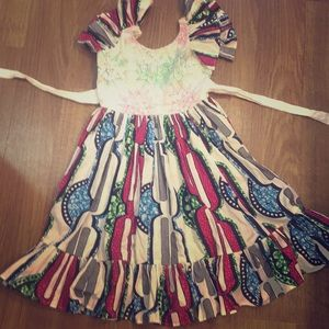 Pink blue white and green ruffle African dress